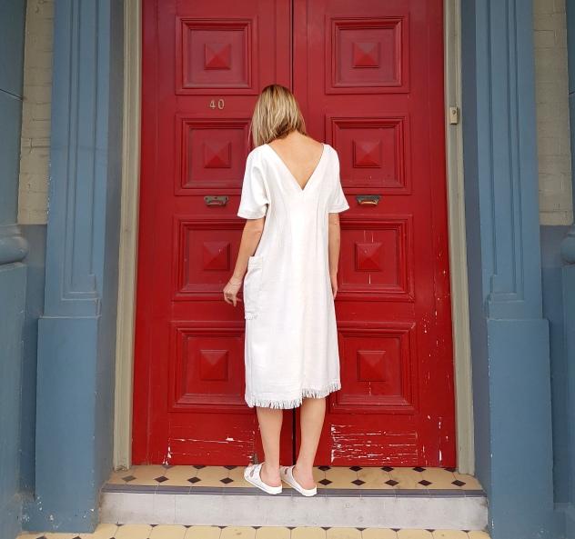 white-dress-pocket-back-wide-shot